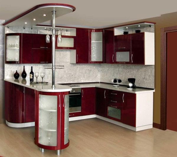 С барной стойкой позволит создать дополнительное рабочее место или послужит обеденным столом. Также можно встроить в основание стойки ящики.