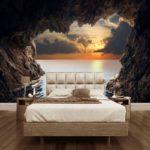 фотообои в спальню с закатом из пещеры