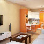 оранжевая кухня с телевизором