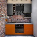 оранжевая кухня с кирпичной стеной